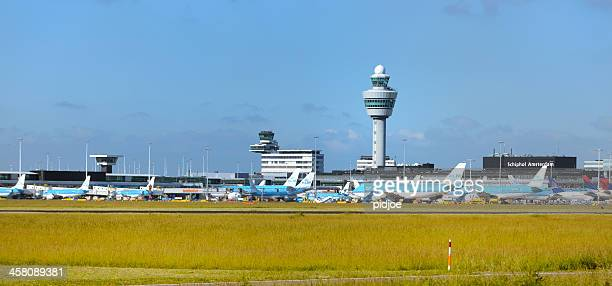 airplanes at amsterdam airport schiphol - schiphol airport stock photos and pictures