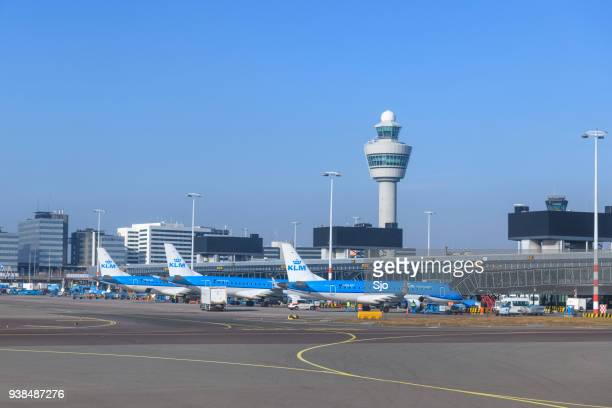airplanes at amsterdam schiphol airport in holland - schiphol airport stock photos and pictures
