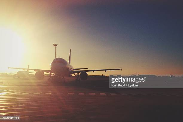 Airplanes At Schonefeld Airport During Sunset