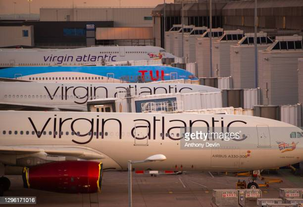 Airplanes belonging to Virgin Atlantic and TUI are parked outside Terminal Two at Manchester Airport on June 01, 2020 in MANCHESTER.