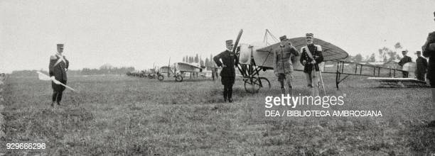 Airplanes deployed on the Mirafiori field presenting honours to the pilots returned from the ItaloTurkish war Turin Italy photograph by N Fornari...