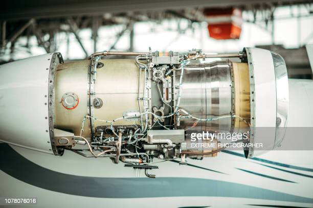 airplane's engine uncovered for maintenance in a hangar - fuselage stock pictures, royalty-free photos & images