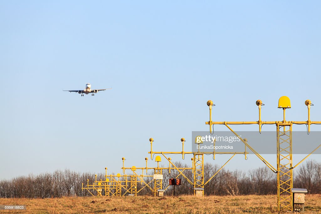 Airplane's landing : Stock Photo