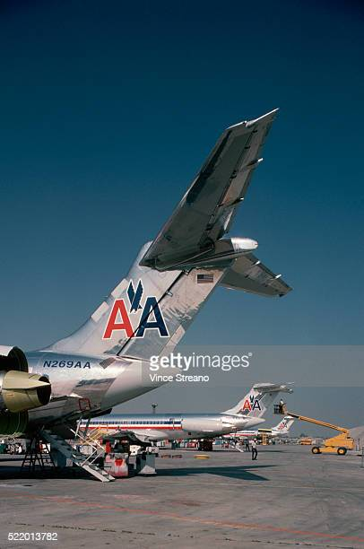 airplanes lined up on tarmac - american airlines stock pictures, royalty-free photos & images