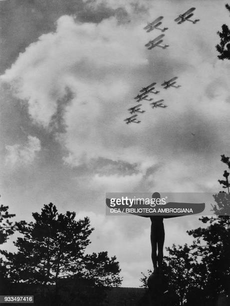 Airplanes of the Richtofen Squadron flying above the aviation monument at Doberitz Germany photograph from The Illustrated London News August 31 1935