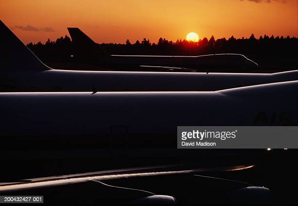 airplanes on runway at airport, sunset - narita international airport stock photos and pictures