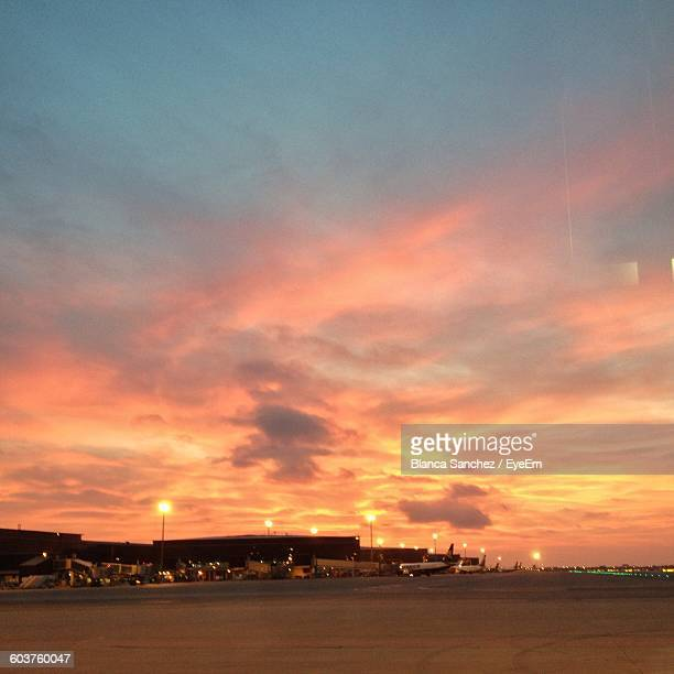 Airplanes On Runway At Barcelona International Airport During Sunset