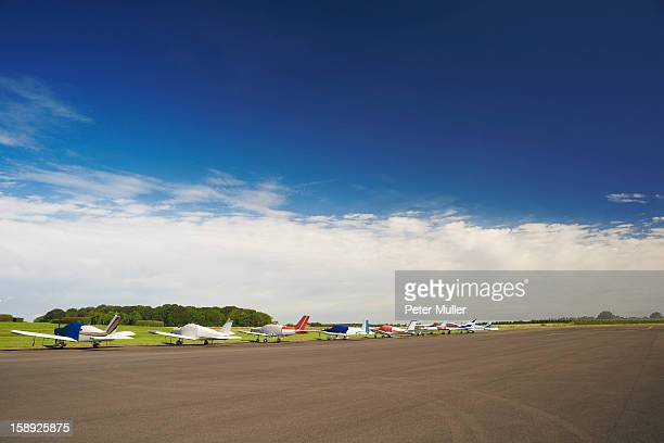 Airplanes parked on airstrip