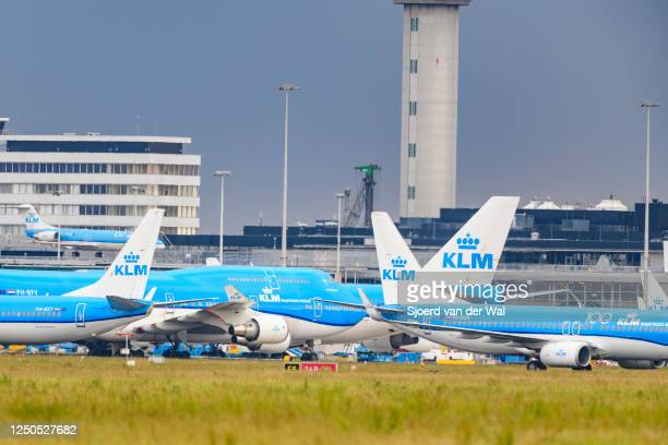airplanes parked on the tarmac of Schiphol Airport with a Boeing 747 Jumbojet passing in front of the airplanes on June 18 near AmsterdamNetherlands...