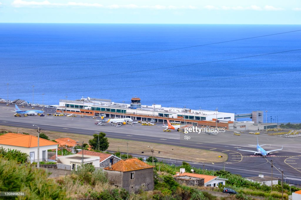 Airplanes taking off and landing at Airport Cristiano Ronaldo on the Island Madeira, Portugal : Stock Photo