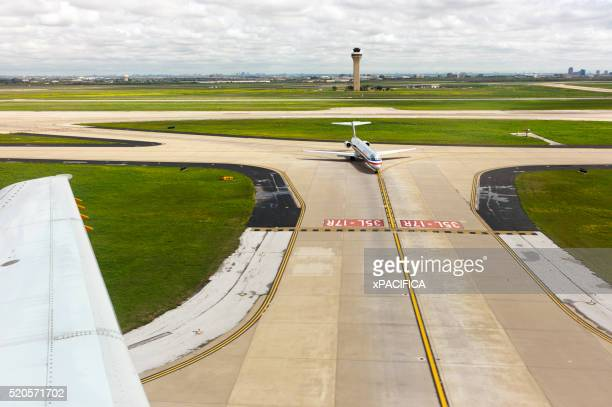 airplanes taxing on the runway - american airlines stock pictures, royalty-free photos & images