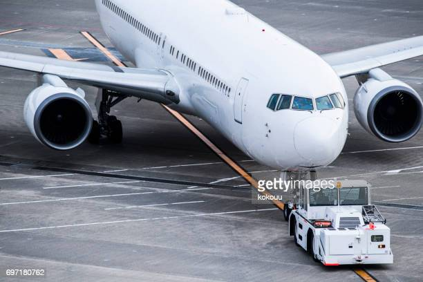 Airplanes, tires and trucks at the airport.