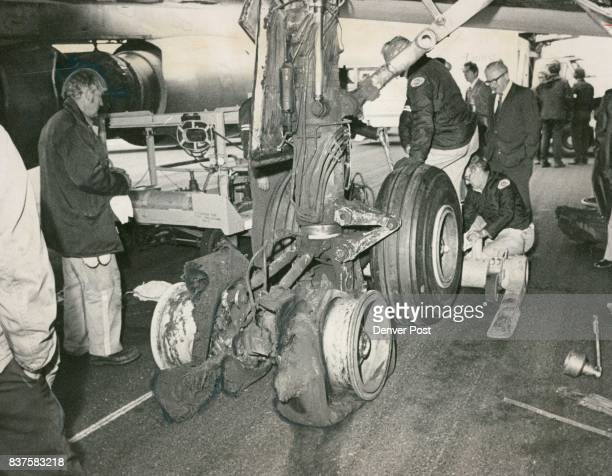 Airplane's Tires Blow Out During Landing Airport maintenance men work to replace four shredded tires which blew out Monday afternoon shortly after...