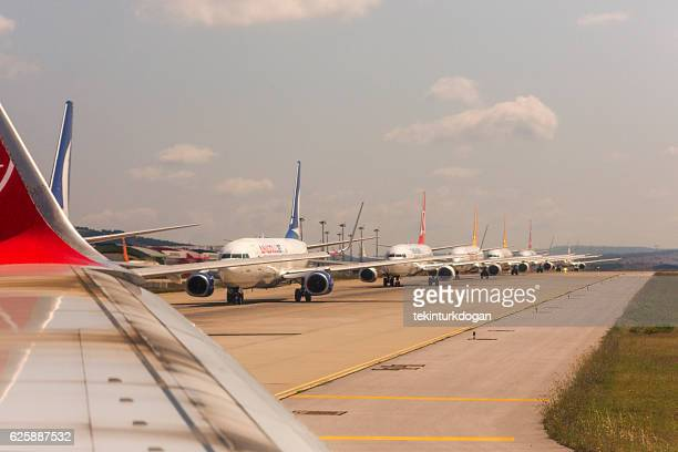airplanes waiting line to take-off at sabiha-gokcen airport istanbul turkey - international air transport association stock pictures, royalty-free photos & images