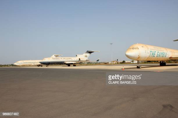 Airplanes which belonged to former Gambian President Yahya Jammeh are parked on the tarmac of the airport in Banjul on May 21, 2018. - Gambia's...