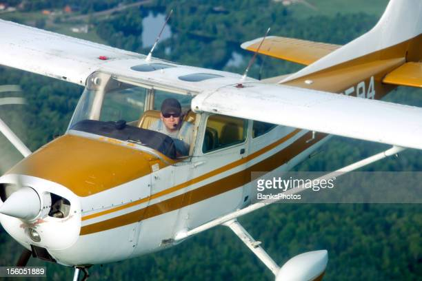 airplane-to-airplane shot of a classic plane flying over trees - next to stock pictures, royalty-free photos & images