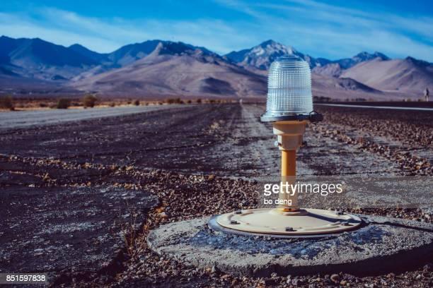 Airport Air Strip Signal Light against mountain range