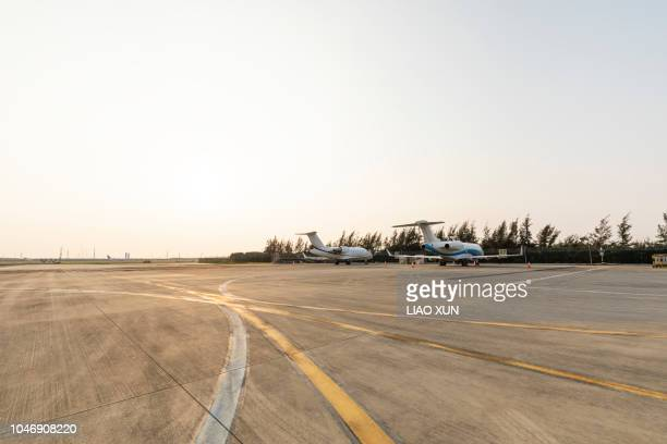 airport apron at sunset - airfield stock pictures, royalty-free photos & images