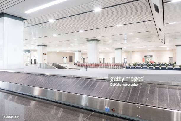 airport baggage claim area. - baggage claim stock photos and pictures