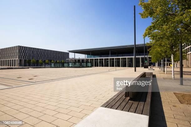 airport berlin-brandenburg terminal with empty benches (schönefeld, germany) - land brandenburg stock-fotos und bilder