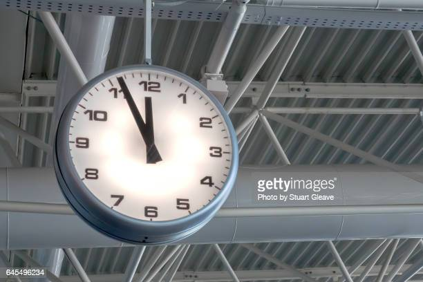 Airport clock approaching midday