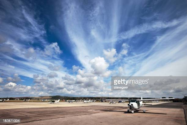 Airport Cloudscape and Light Planes