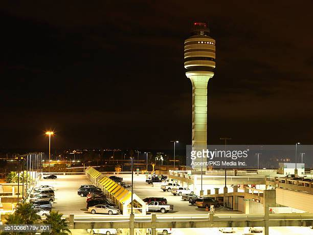 Airport control tower and parking lot, night