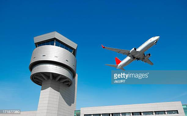 Airport control tower, passenger airplane