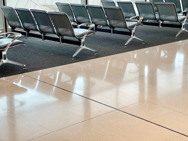 Airport departure area with chairs, no people, COVID-19