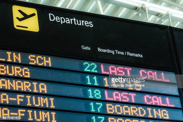 airport departures board - boarding stock pictures, royalty-free photos & images