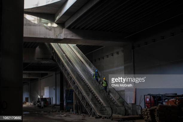 Airport employees are seen working in a section of the arrivals area of the Istanbul New Airport on October 9 2018 in Istanbul Turkey Construction...