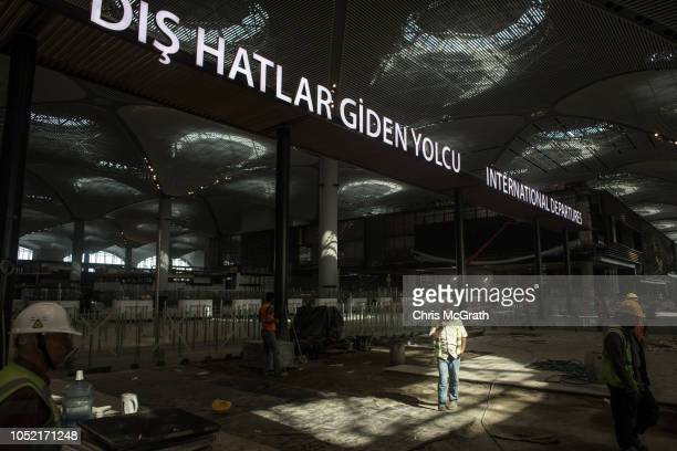 Airport employees are seen working in the entrance area of the main terminal of the Istanbul New Airport on October 6 2018 in Istanbul Turkey...
