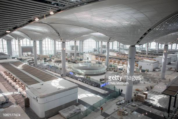 Airport employees are seen working in the main entrance hall of the Istanbul New Airport on October 6 2018 in Istanbul Turkey Construction continues...