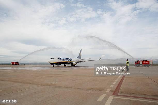 Airport fire trucks baptize the first commercial flight landing at Castellon airport on September 15 2015 near Castellon de la Plana in Castellon...