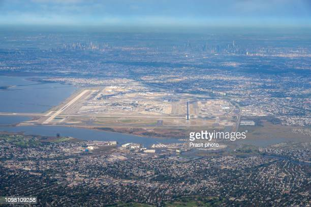 JFK Airport from Above with New York city in background in USA.