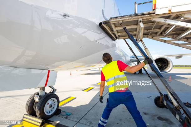airport ground service at work - izusek stock pictures, royalty-free photos & images