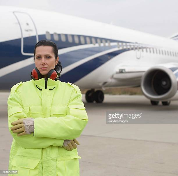 airport hangar worker on tarmac - airport tarmac stock pictures, royalty-free photos & images