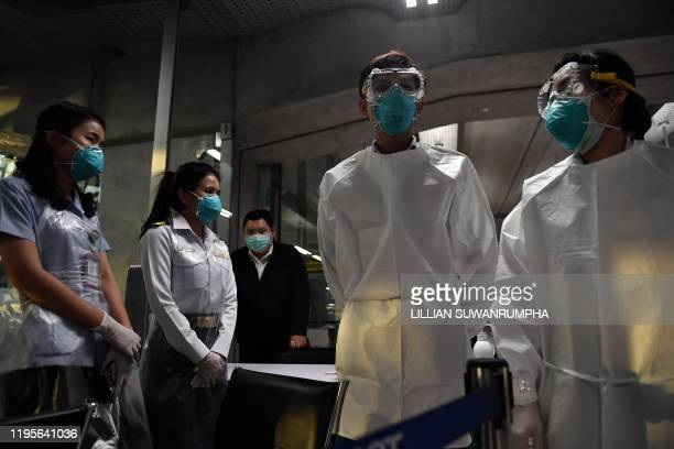 Airport health officers wearing protective clothing are posted at the passengers arrival area at Suvarnabhumi International Airport in Bangkok on...