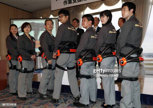 Airport Limousine bus service emloyees display robot suit Hybrid Assistive Limb developed by Cyberdyne at the Haneda airport in Tokyo on November 24...