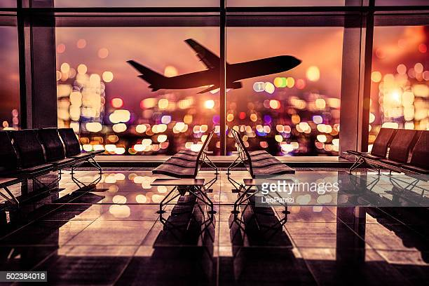 airport lounge and airplane take off in the city - high society stock pictures, royalty-free photos & images