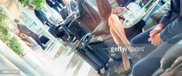 airport lounge - cross legged stock pictures, royalty-free photos & images