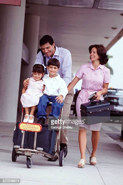 Airport luggage cart family
