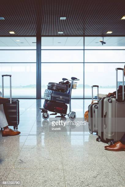 airport luggage trolley with suitcases - luggage rack stock photos and pictures