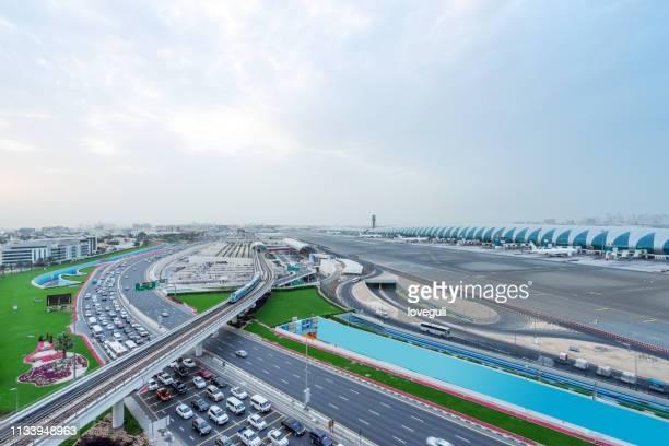 airport of dubai - dubai airport stock photos and pictures