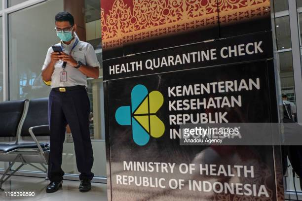 Airport operational officers are seen using a face mask to prevent Coronavirus at Sultan Syarif Kasim II airport in Pekanbaru Riau Province Indonesia...