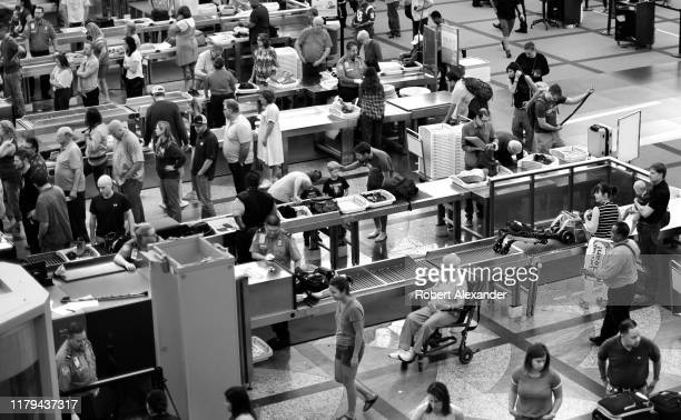 Airport passengers proceed through the TSA security checkpoint at Denver International Airport in Denver Colorado