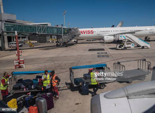 Airport personnel loads luggage onto an airplane before departure at Terminal 1 of Barcelona El Prat Airport on September 10 2017 in Barcelona Spain...