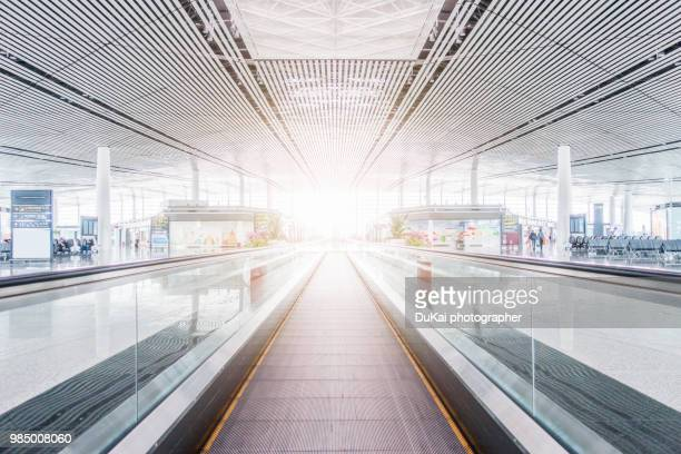 airport - pedestrian walkway stock pictures, royalty-free photos & images