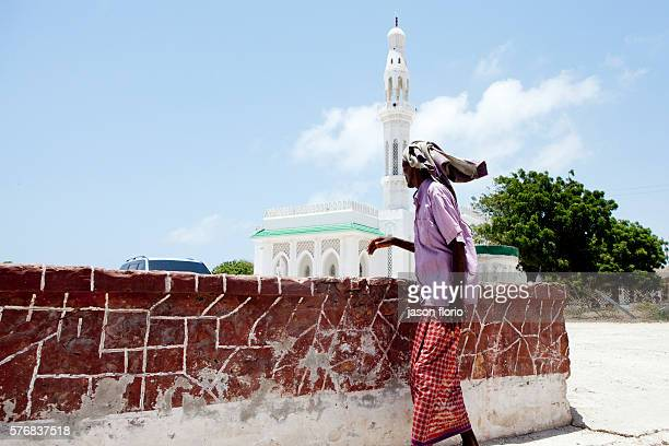 Airport Road MogadishuSomaliaa man walks past a mosque in an area recently rested from al Shabaab Islamists and now controlled by the Somalia...