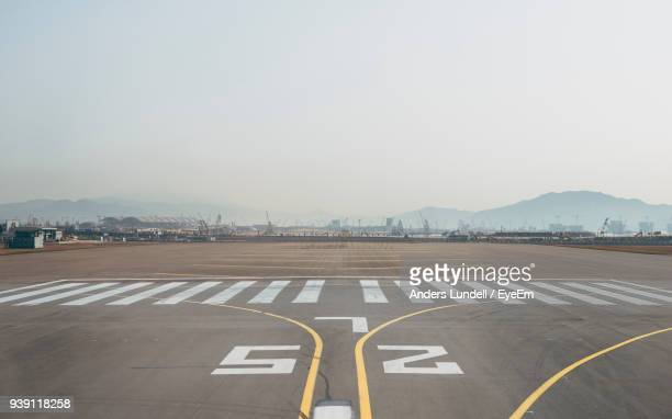 airport runway against sky - airport runway stock pictures, royalty-free photos & images